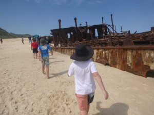 Kids view the majestic wreck of the Maheno