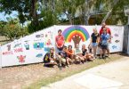 Michael Grogan with Year 6 students and their new mural at Rainbow Beach Police Beat