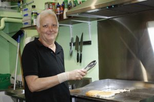 Clair Picot is cooking up burgers at Rainbow Beach Fruit