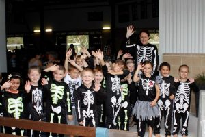 Prep 1 skeletons are shepherded by teacher Stacey Searl
