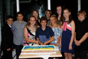 RBSS graduates Jarrod, Archie, Annie, Zaraya, Charlie, Noah, Emma, Ivy, Ruby and Oscar are ready to cut the cake at the Surf Club!