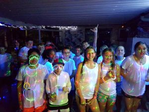"""The neon pool party for Tin Can Bay Year 6 was called an """"awesome"""" celebration"""