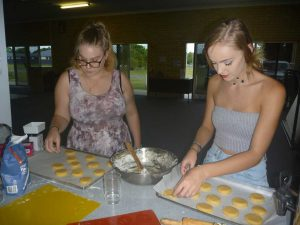 CCYAP - Shervawn Wilson and Britney Rose cutting cookies