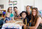 Isabel Phelan and Kai Riehl-Posadowski are smiling already as family watches on - Lucia, Grant and Olivia Phelan, Aaron Posadowski and Carla Riehl