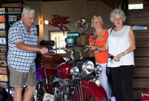Over 60's - Friends from Probus Don Beaton, Judy Kiddle and Yvonne Denniss with a great red Indian vintage motorbike