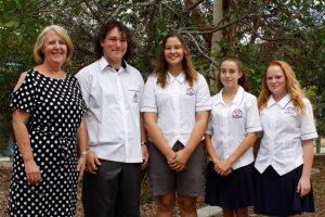 Principal Desley Kirby congratulates Secondary School Captains Braden Gray, Tehmia Masri, Vice Captain Anna Dunstan, and Student Leader Chelsea Brennan