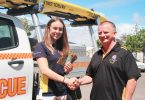 Summer Surf Girl, Elizna Smit, receives a very generous donation from PFD Foods, presented by Surf Club Supporters Club President, Mr John Greaney Image Barb Rees
