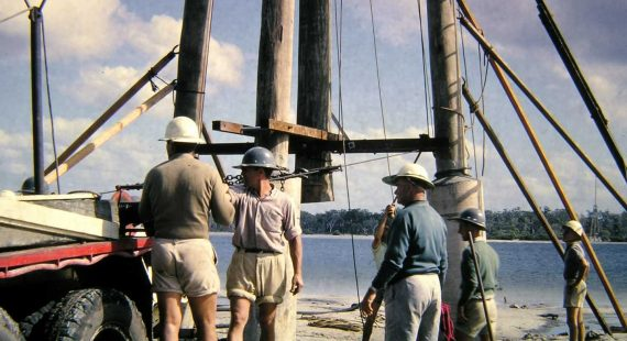 Energex electrician, Ian Ross's photo from July 1965 onsite building the power line across Tin Can Bay Inlet
