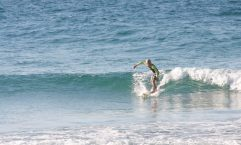 10-year-old Seth Parton surfs at Double Island Point