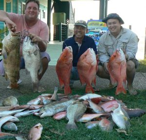Mick with his cod and 4.7kg pearl perch, Nguyen and his father with a nice haul.