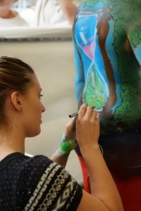 Repeat winner at the Mary Valley Art Festival is Holly Hughes, pictured creating body art