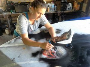 Kandanga artist Holly Hughes will return with a unique new art concept – using ultraviolet paint on surfboards to celebrate our underwater wildlife