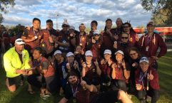 23-year-old Shane Berkhout won a bronze medal at the Australian Dragon Boating Championships, behind him is the Queensland Premier Men and Women's Relay Teams