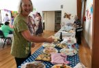 CIRS Treasurer Helen Brown helps out at the charity morning tea last month - and hopes that you may be able to help her?