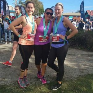 All smiles: Podiatrist, Rochelle Harling, local Tori McIlroy and friend Rhian at the Great Ocean Road Run