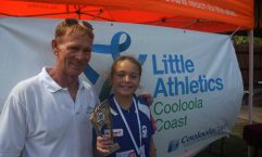 Coach Bill McKechnie presents Anjelica Geurts with Cooloola Coast Little Athletics 2016 Athlete of the Year