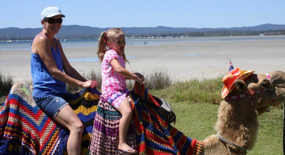 The 2017 Tin Can Bay Seafood Festival is set to be the best yet. Wynetta and Skye Duggan took the camel train around the foreshore last year, and the day out is definitely one of the highlights of the year!