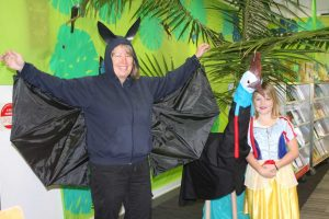 "Mrs Theresa Dargusch or ""Batty"" from Fern Tree Gully, created a Reading Rainforest at RBSS Library - with a snake ""Snow White"" Lily very impressed with the cassowary"