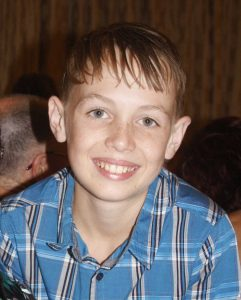Tristan Sik remains in an induced coma, as prayers flow for his recovery (image from Rainbow Beach State School Grade 6 Graduation)