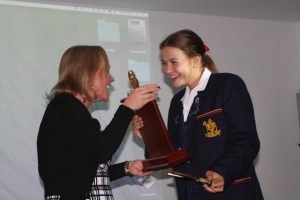 Principal Dr Julie Wilson Reynolds presents Kate with the Ammonite Award - St Hildas's Rowing's highest honour