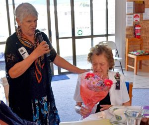 Joan Barnier presents Francis Sheppard with her birthday flowers - congratulations on 91 years!