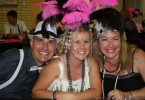 Pink and black feathers themed up the tables, and Yvonne Jensen didn't mind borrowing it to glam up further with husband Russell and friend Michelle Heaton