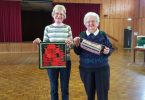 Tin Can Bay Quilters Coral Welham with a fractured quilt and Eunice Coombs with a utility bag