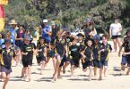 The RBSS Fun Run is about to start at the flags on Rainbow Beach….