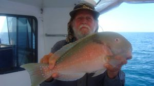 Fishing Club member Ron Cox with a parrot