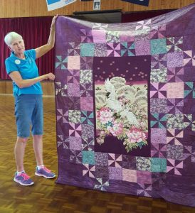 Sandra Bonnell and her beautiful quilt