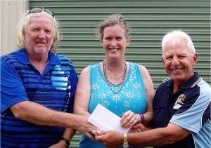 Margie Moore and Mark Wotherspoon of TCB won First Prize in the Club's Raffle are presented with a cheque for $1000 by President, Jim George