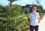 Tin Can Bay IGA Manager, Kylie Rayson, shows some of the new plantings and beautification in the Tin Can Bay shopping precinct