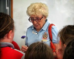 Keeping The Legacy Alive: Melissa Haslam's photo of Pam Leslie, awarded Life Membership of the RSL QLD Branch was taken with Pam surrounded by the school children at one of her many school visits. Not much taller than the children, Pam is explaining the history of the poppy in preparation for Anzac day last year.
