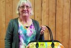 June Fraser made an overnight bag made with small pieces of fabric in a design called 'crazy patch' with machine embroidery