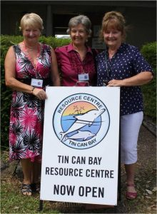 Volunteers Gabriella Field, Lynette Cunningham and Eileen Hollyoak show off the Resource centre's brand new sign