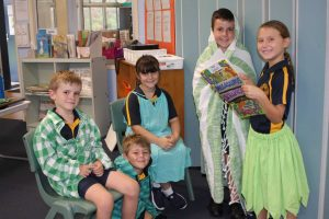 Students at Rainbow Beach State School, Darcy, Jimmy, Delilah, Murphy and Skye look forward to presenting limericks on St Patrick's Day