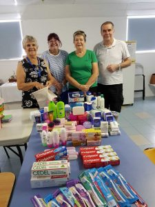 QCWA Member Joan, Debbie, Dawn and Mark with some of the Care Pack items