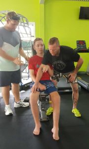Tristan Sik is building strength with Dad and Personal Trainer Mark at the Rainbow Beach Gym Image supplied