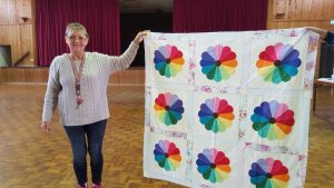 Linda Pottle with a Dresden Plate quilt