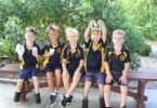 Rainbow Beach State School preppies, Casey, Zay, Roy, Liam and Darcy enjoy a sausage and game of handball at the Welcome BBQ.