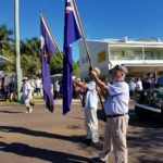 Flag bearers are ready for the procession