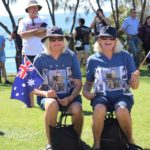 Patriotic twins, Collette Archibald and Coralie Leslie wore matching t-shirts featuring their serving daughter and niece