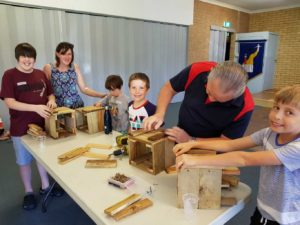 Busy little bees enjoy making planter boxes with Paul Vick