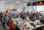 Frayed Edges members creating the bunting for the You Make My Heart Sing - Small Halls events.