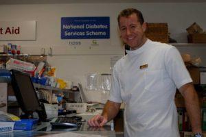 New pharmacist, Richard O'Donohue, hard at work at Rainbow Beach Pharmacy