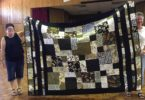 Leonie proudly displays her Layer Cake quilt