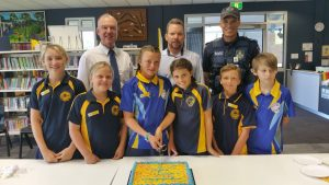 Tony Perret, Principal Danny Stanieg and Michael Brantz congratulate school leaders, Laila, Mason, Luxie-Leigh, Tia, Max and Jasper