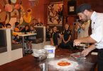 Chef Michael Lindemeier from Arcobaleno on the Beach helps Class 2-3 create their very own pizza