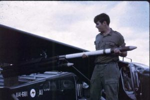 Local Veteran, Bob Carroll loading rockets in Vietnam