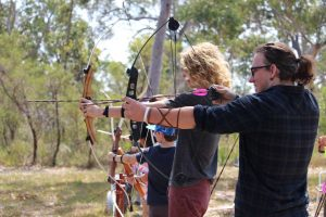 Zach and Braden about to let their arrows go at the previous archery activity day